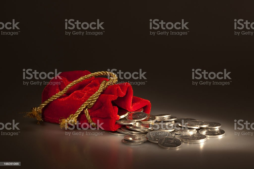 Red pouch with coins royalty-free stock photo