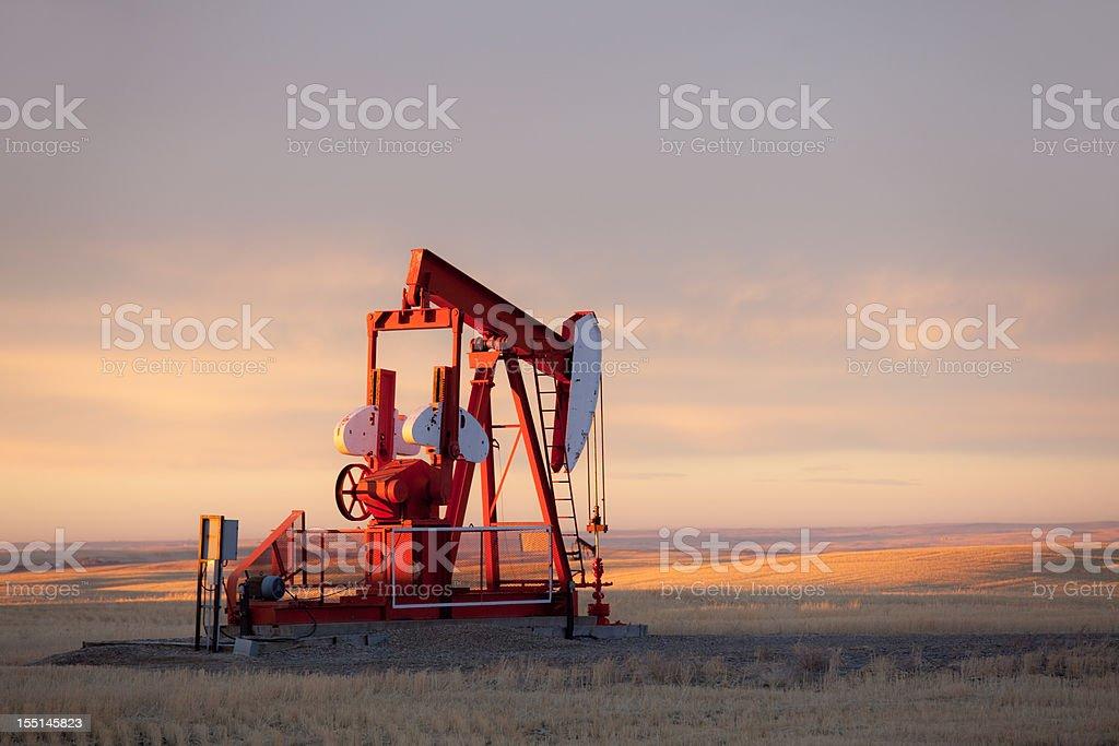 Red Prairie Pumpjack in Alberta Oil Field stock photo