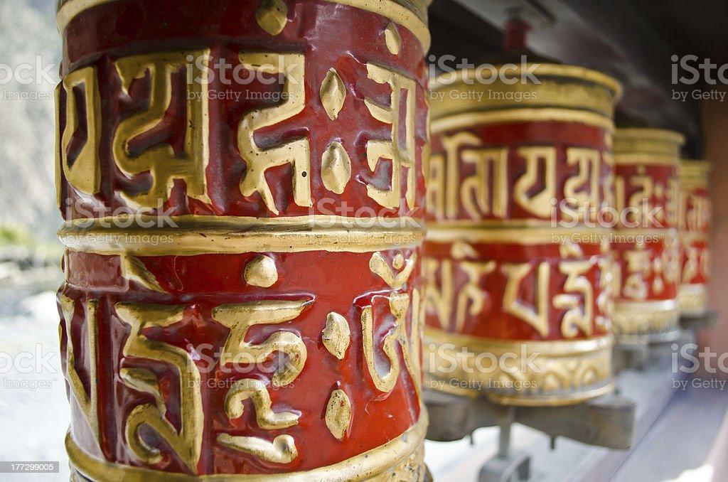 red prayer wheels in nepal royalty-free stock photo