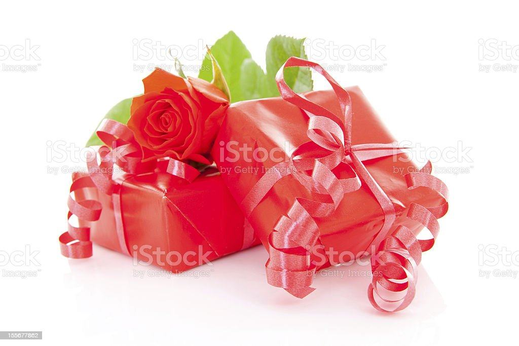 red presents and rose stock photo