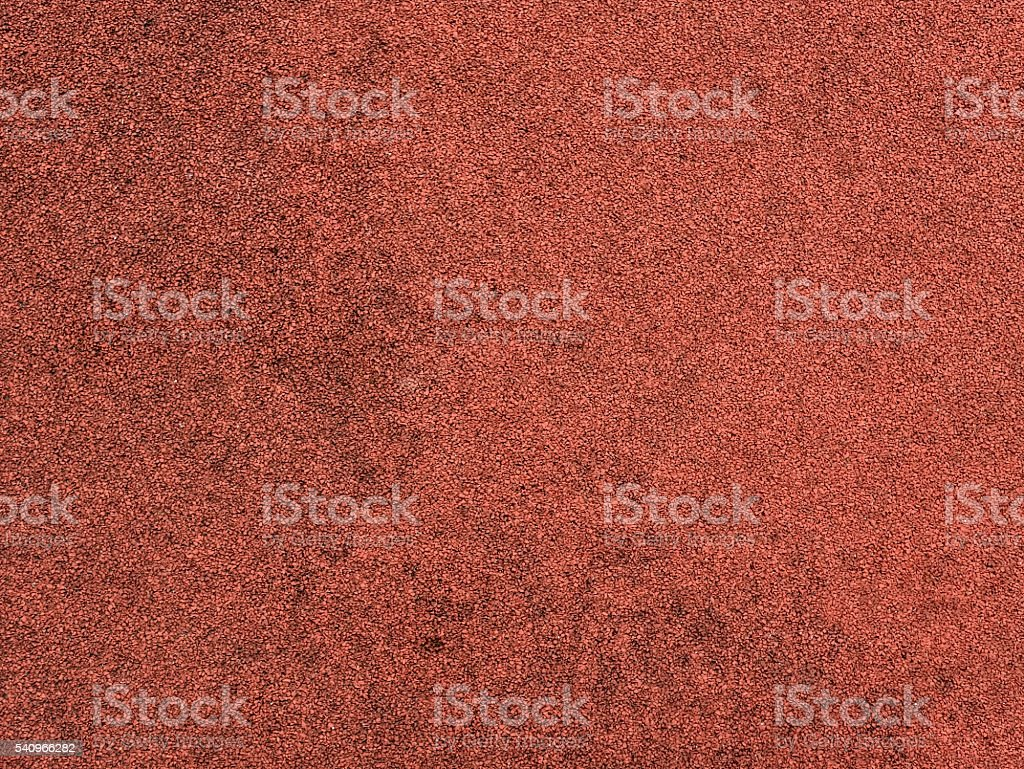 Red protective rubber coating for sports and children playgrounds. Texture stock photo