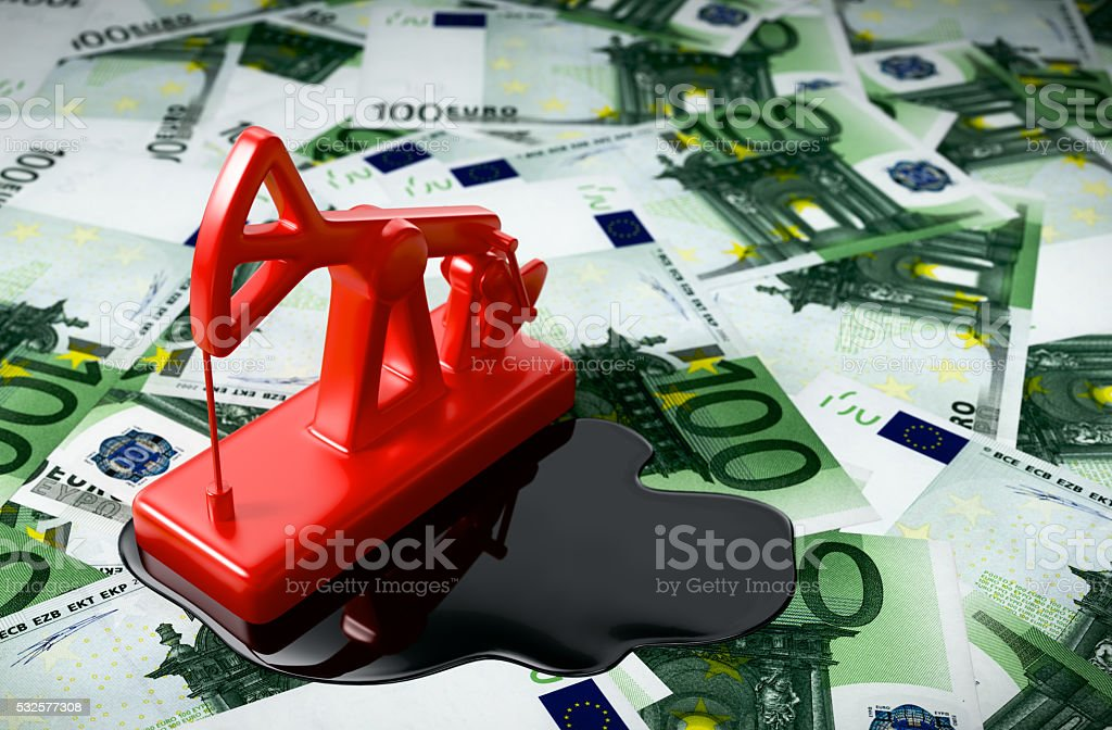 Red Pumpjack And Spilled Oil On Euros stock photo