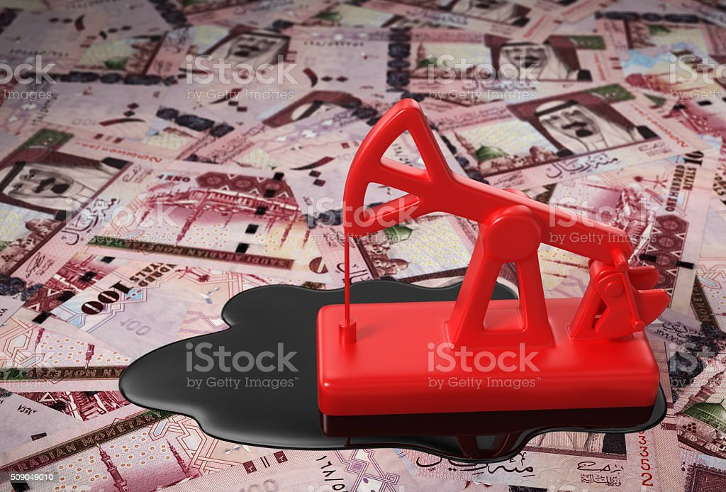 Red Pumpjack And Spilled Oil On Saudi Riyals stock photo