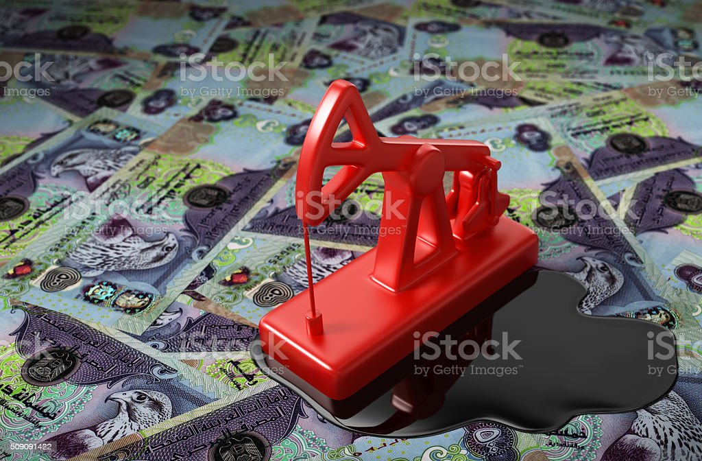 Red Pumpjack And Spilled Oil On United Arab Emirates Dirham stock photo