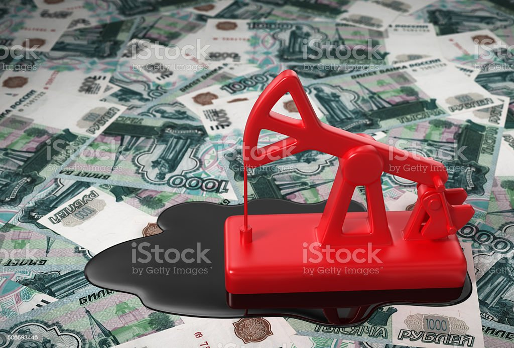 Red Pumpjack And Spilled Oil Over Russian Rubles stock photo