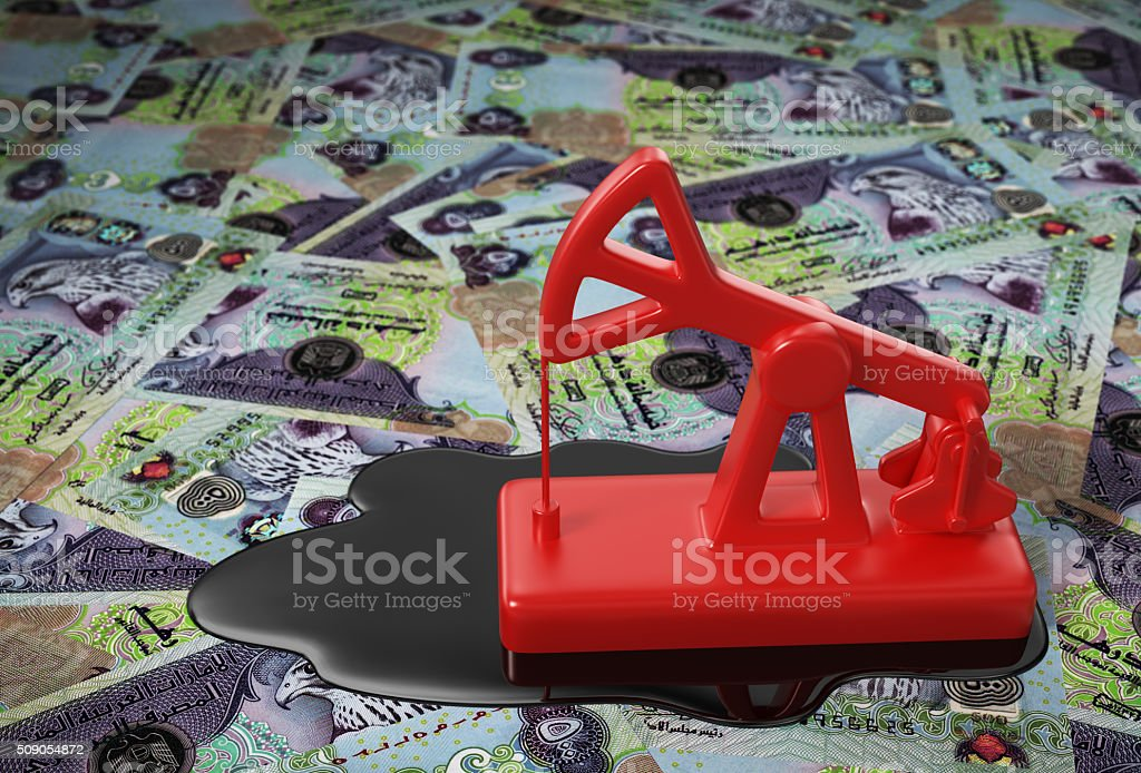 Red Pumpjack And Spilled Oil Over United Arab Emirates Dirham stock photo