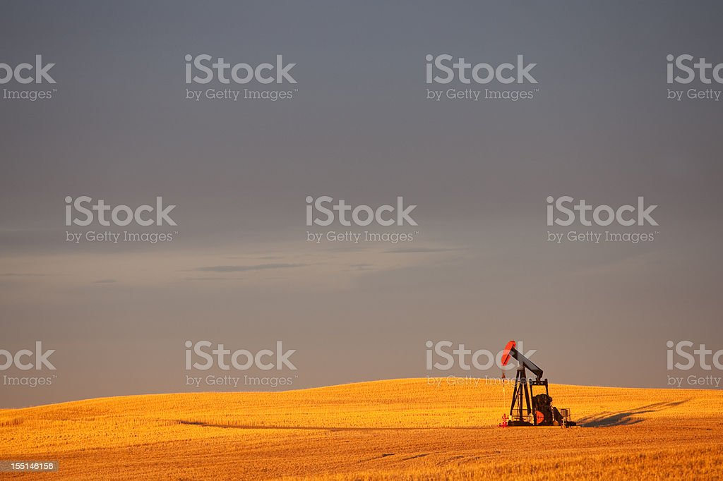 Red Pumpjack in an Oil Field In Alberta Canada royalty-free stock photo