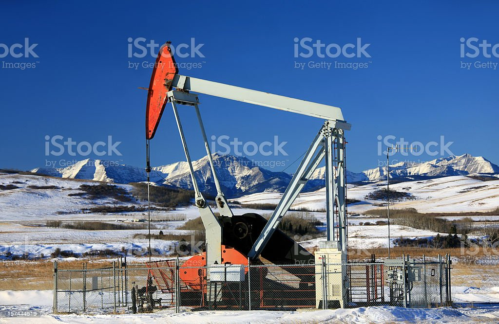 Red Pumpjack in Winter royalty-free stock photo