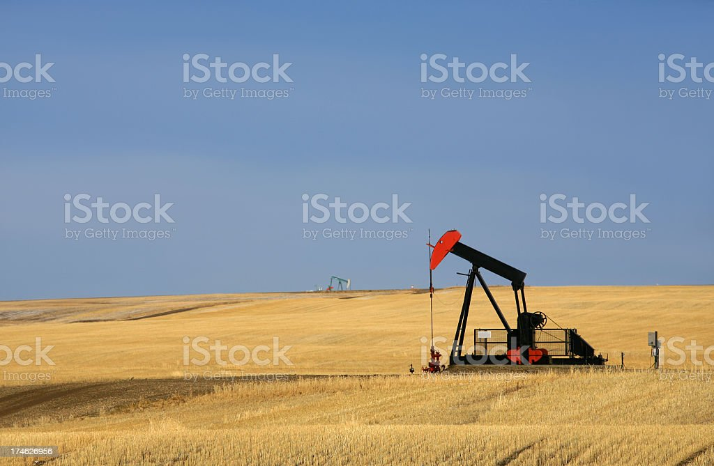 Red Pumpjack on Oilfield in Texas royalty-free stock photo
