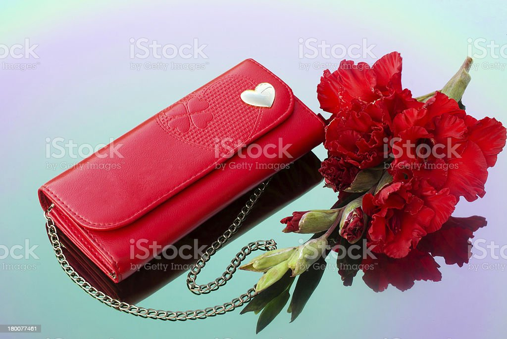 Red Purse with chain and  gladiolus stock photo
