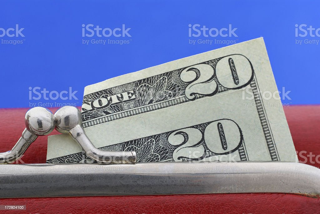 red purse with two twenty dollar bills stock photo