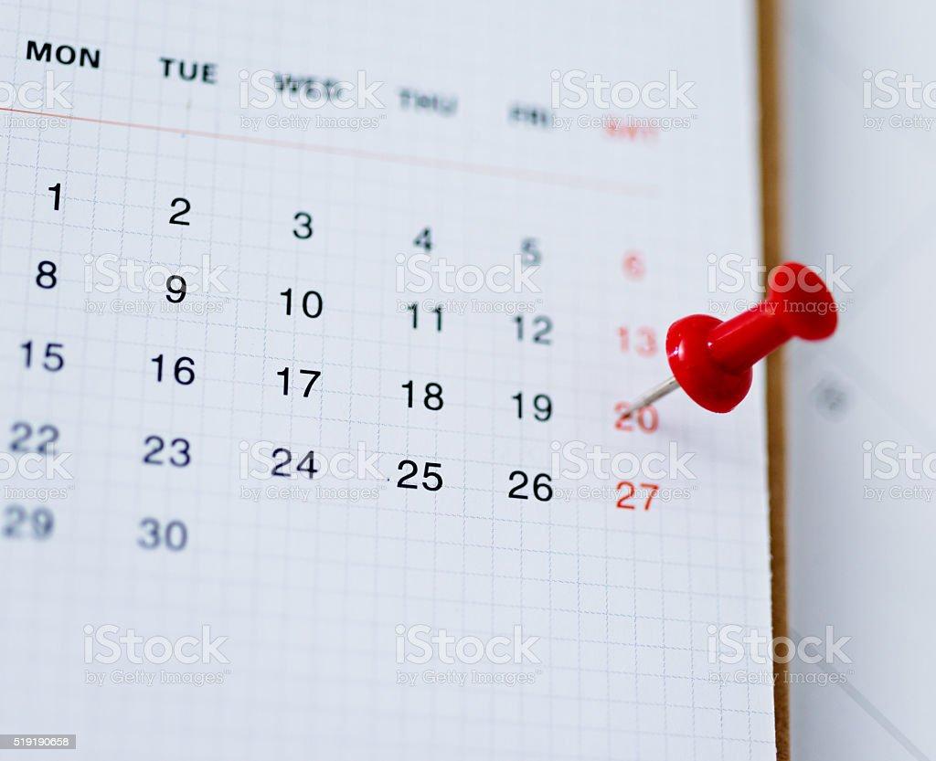 Red push pin in calendar stock photo