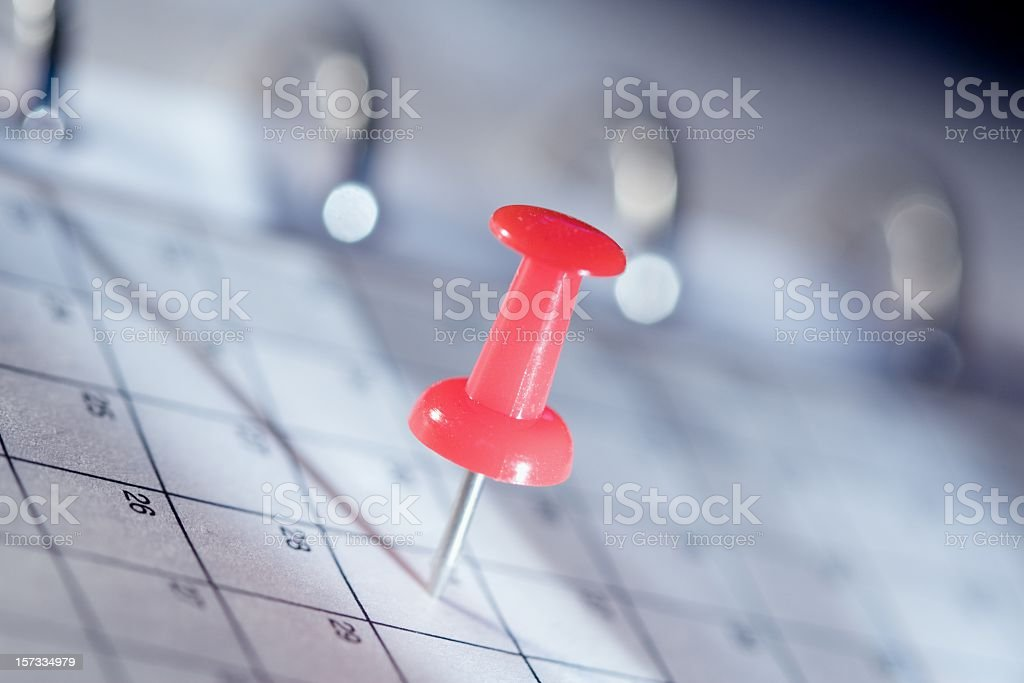 Red push pin in page of spiral binder stock photo