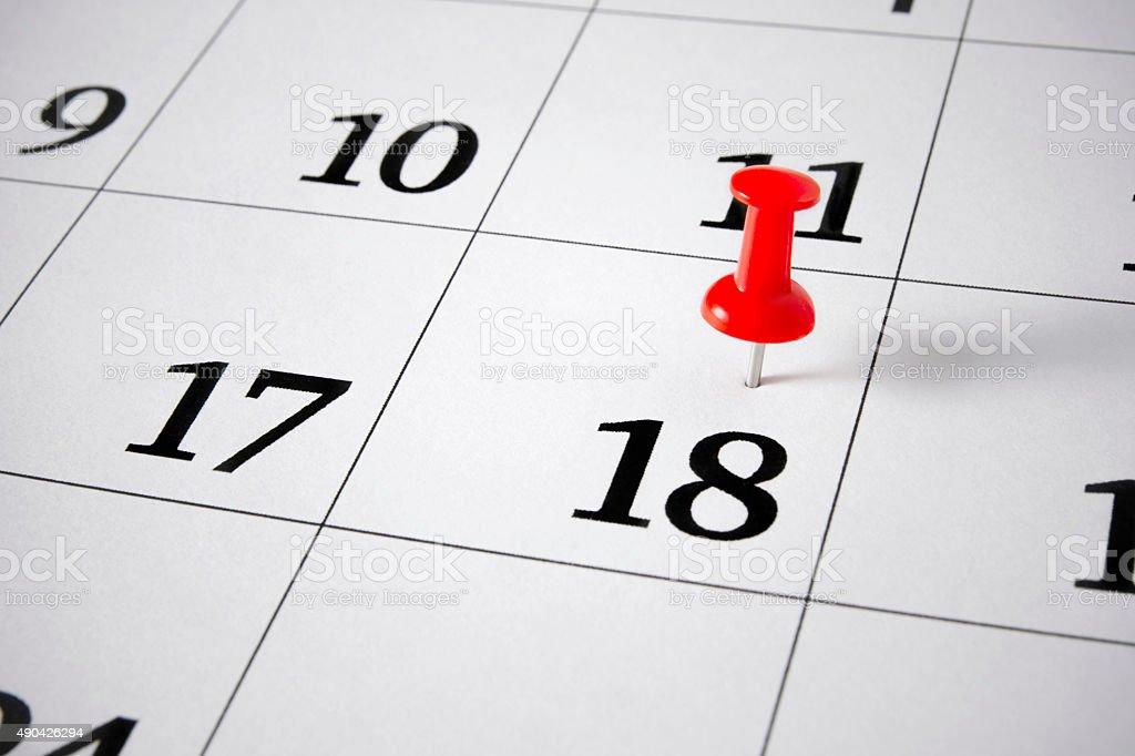 Red Push Pin on Calendar stock photo