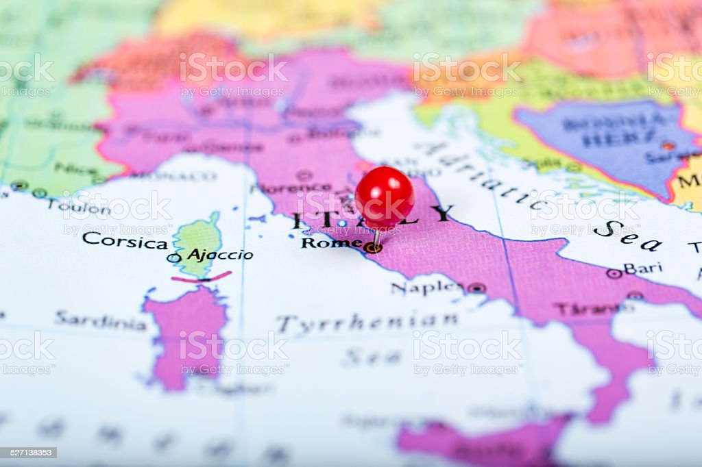 Red push pin on map of Italy stock photo