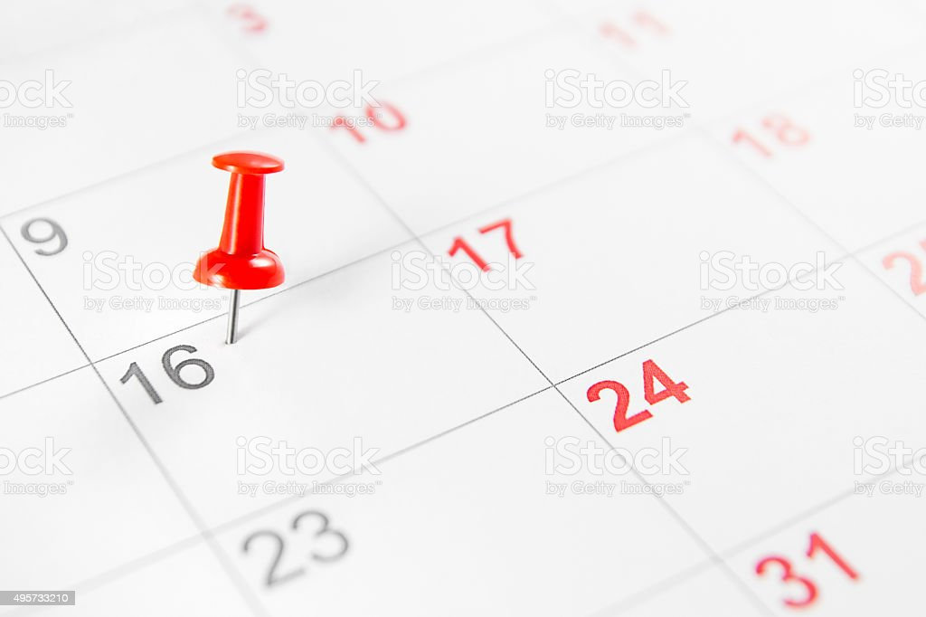 Red Push-Pin on Calendar stock photo