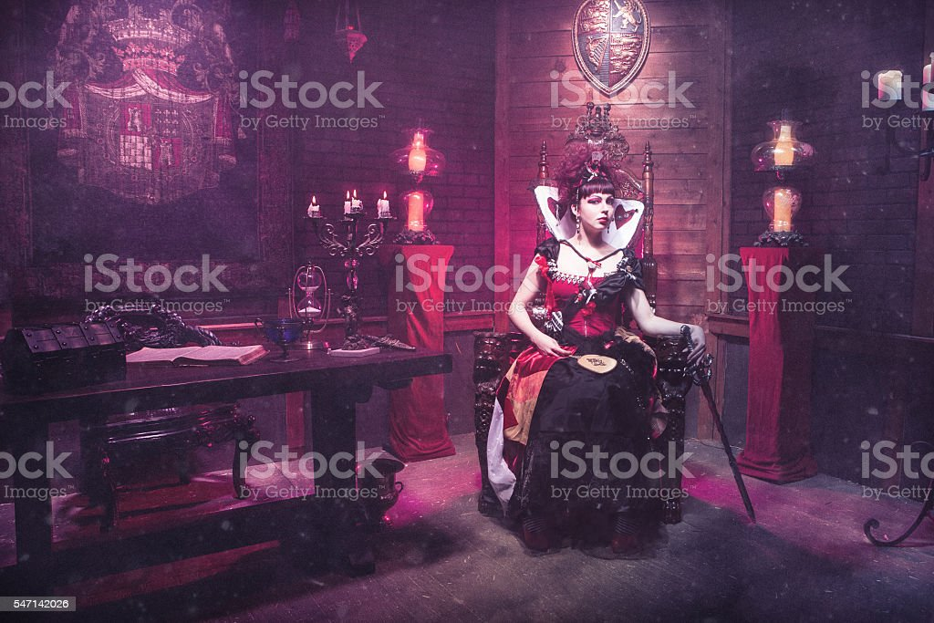 Red Queen of Hearts Sitting on Throne stock photo