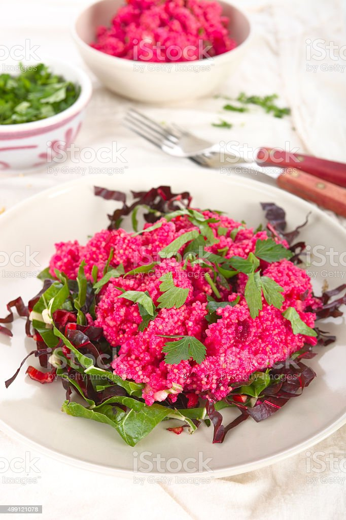 Red quinoa and beet salad stock photo