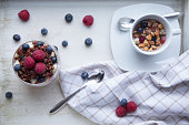 red quinoa and berries breakfast with cup of fruit tea