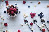 red quinoa with berries and apple breakfast, three spoons