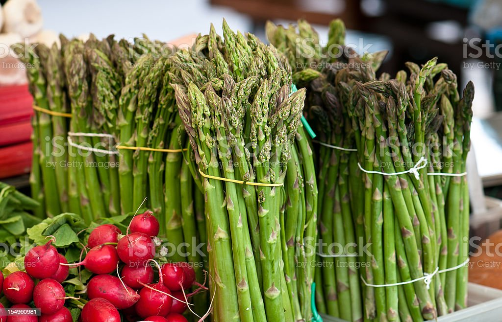 Red radish and asparagus in a street vegetable market, Ljubljana royalty-free stock photo