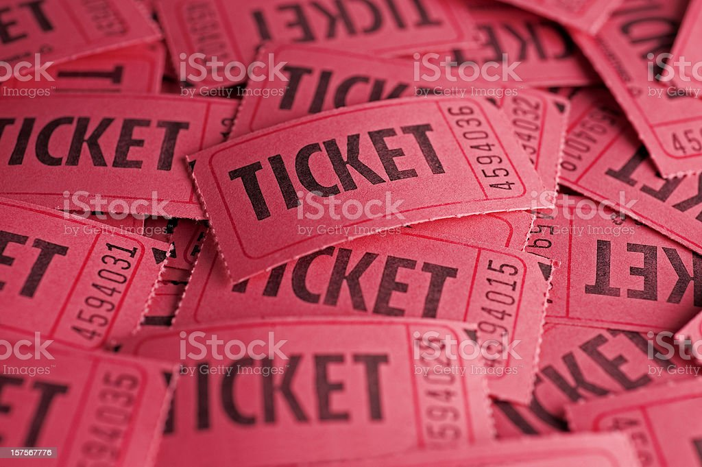 Red raffle tickets scattered and piled up on one another stock photo