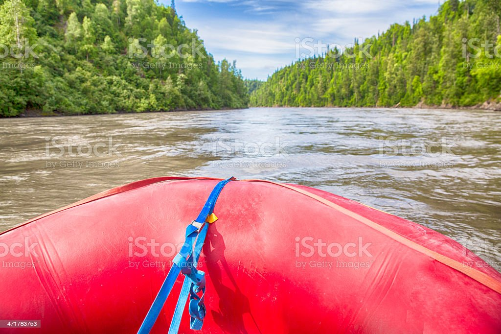 Red raft floating on the river stock photo