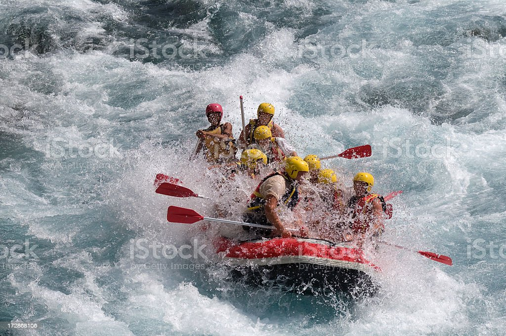 Red raft in violent white water stock photo