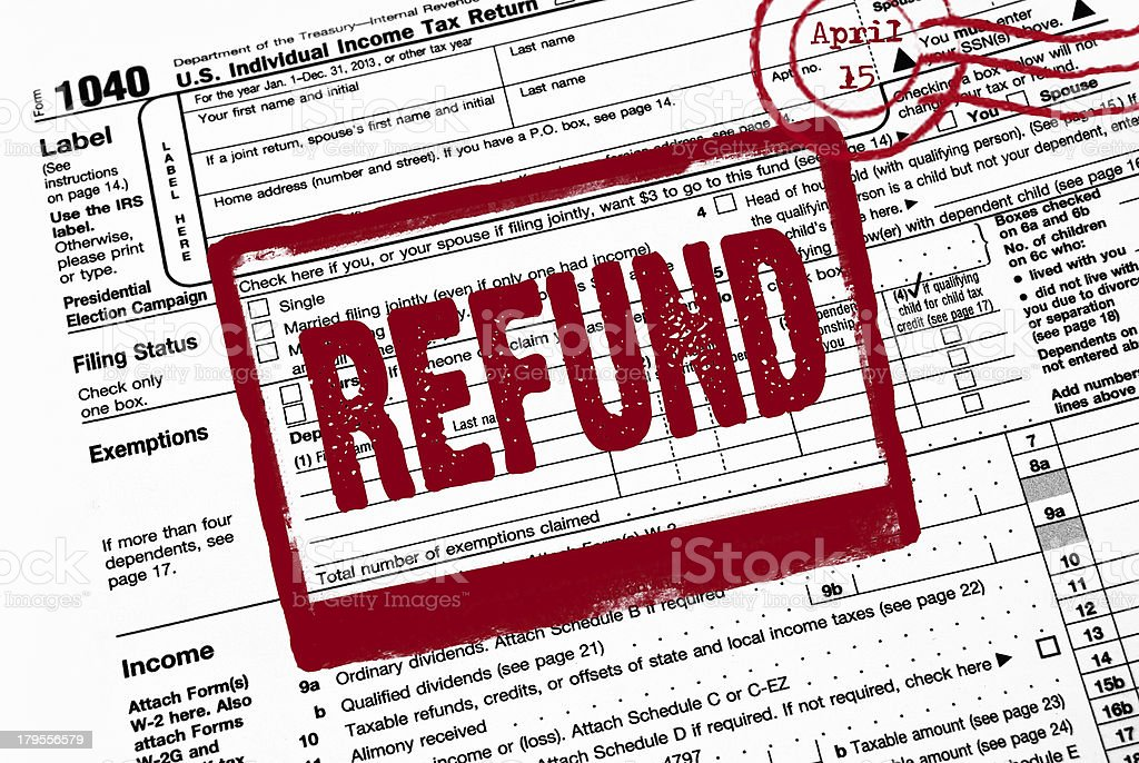 red refund stamp on tax form stock photo