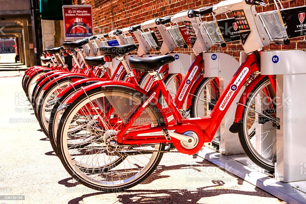 Red rental bicycles in downtown Madison Wisconsin stock photo