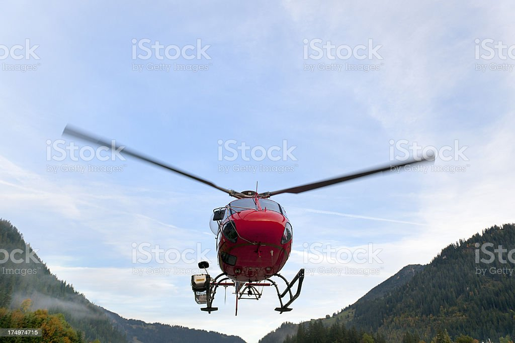 red rescue helicopter landing on airfield stock photo