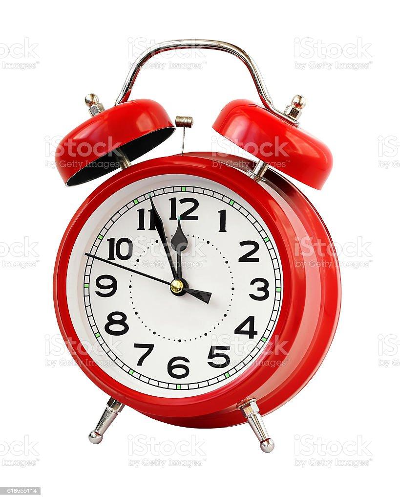 Red retro alarm clock at twelve o'clock, isolate. stock photo