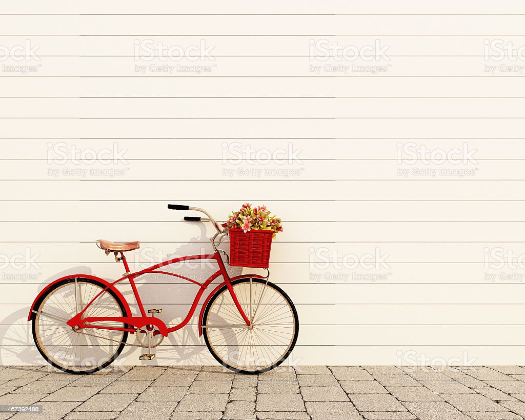 red retro bicycle with basket and flowers stock photo