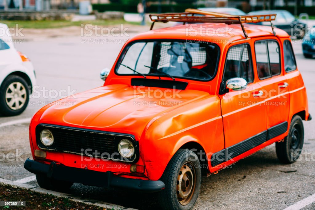 Red retro car in Montenegro, marks of Zastava, production of Yug stock photo