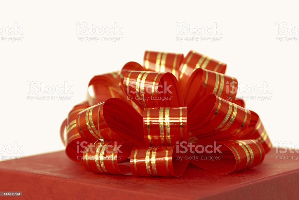 red ribbon and gift box over white background royalty-free stock photo
