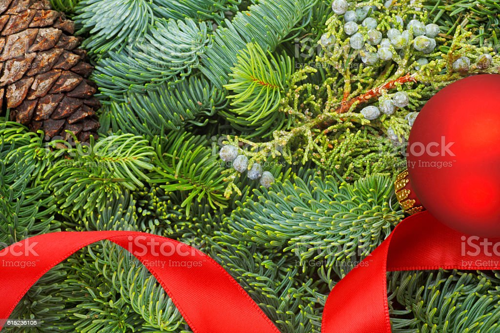 Red Ribbon And Ornament On Christmas Wreath stock photo
