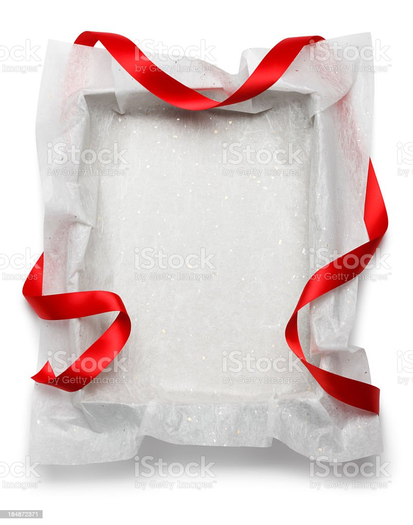 Red ribbon draped around empty gift box on white background stock photo
