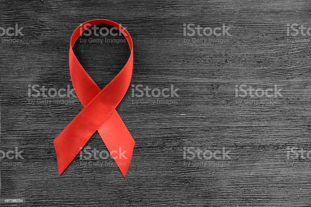 Red ribbon HIV, AIDS stock photo