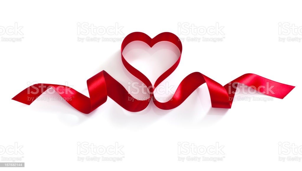 Red ribbon in a heart shape against a white background stock photo