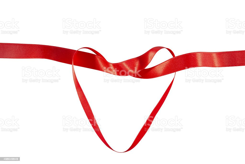Red ribbon in heart shape stock photo
