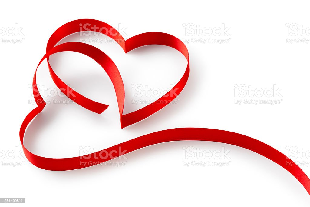 Red ribbon in hearts shape stock photo