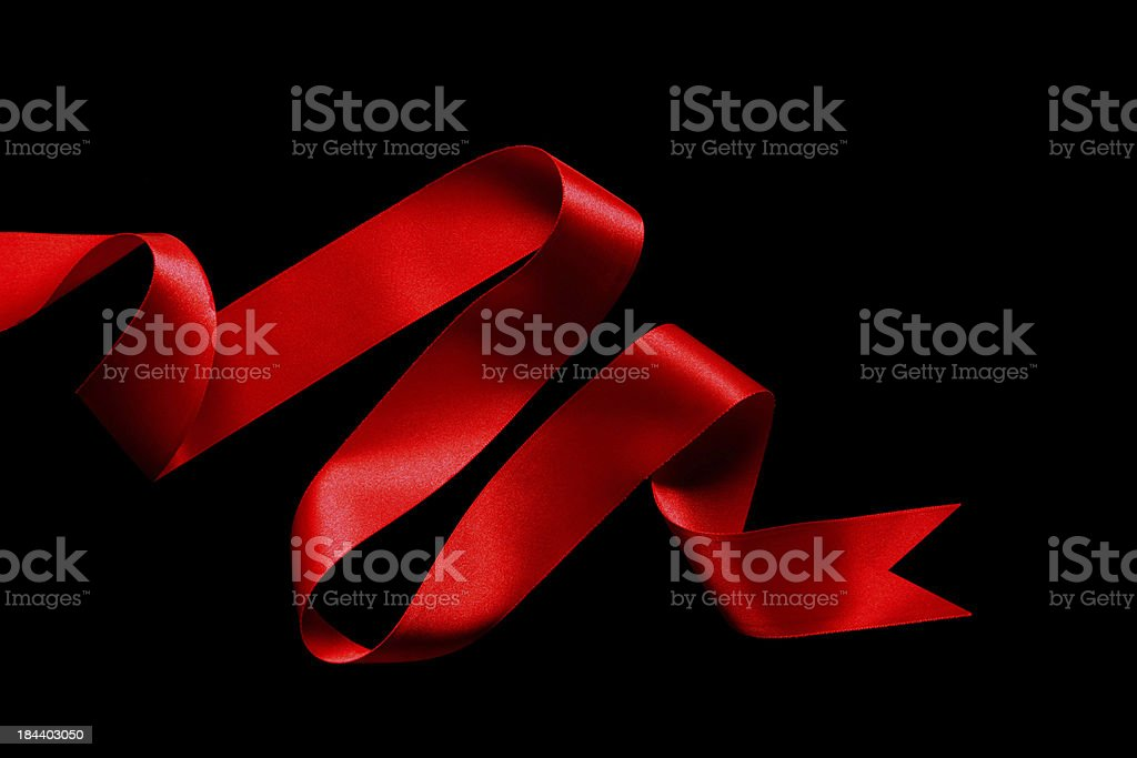Red Ribbon on black background royalty-free stock photo