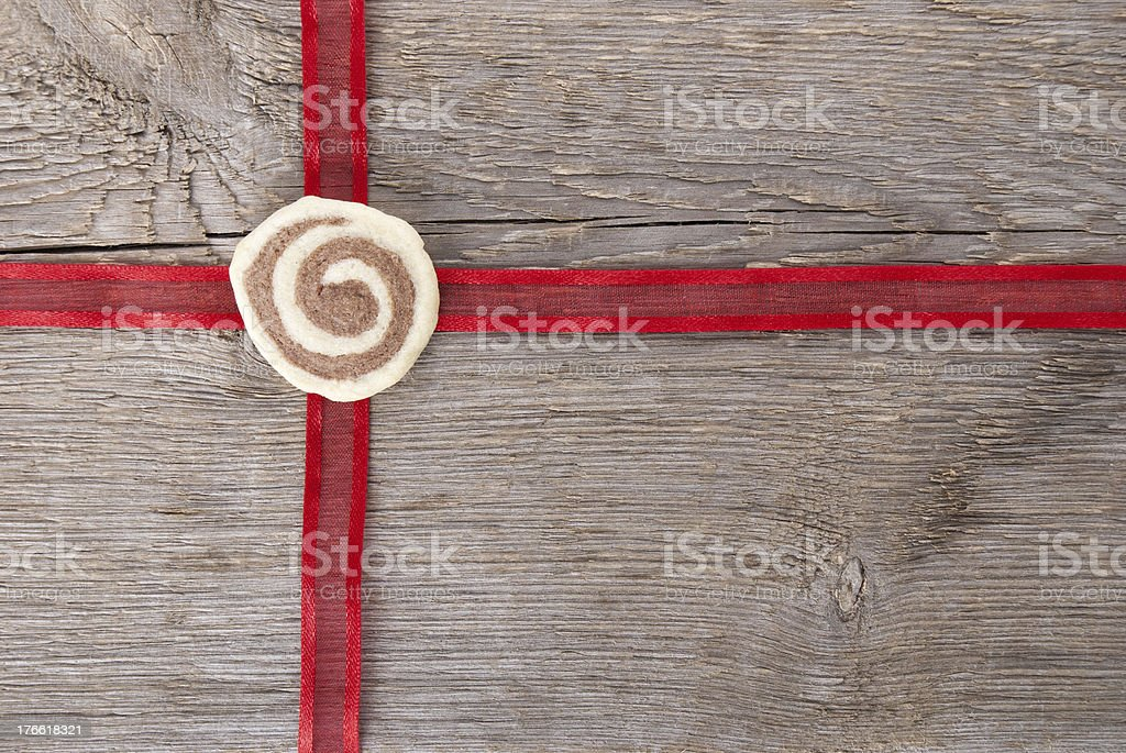 red ribbon on wood stock photo