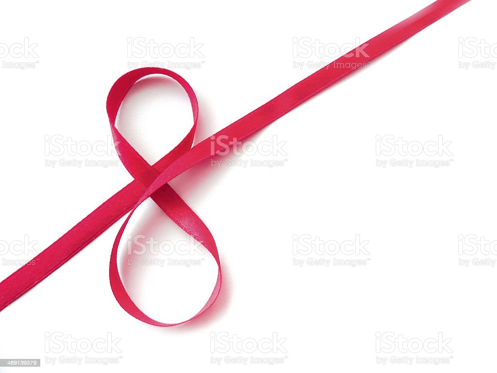 Red ribbon twisted to form Woman's Day symbol stock photo