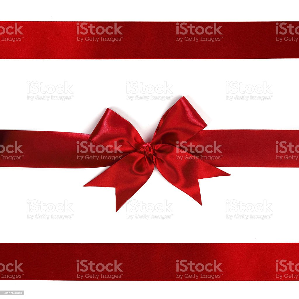 A red ribbon with a bow on white stock photo