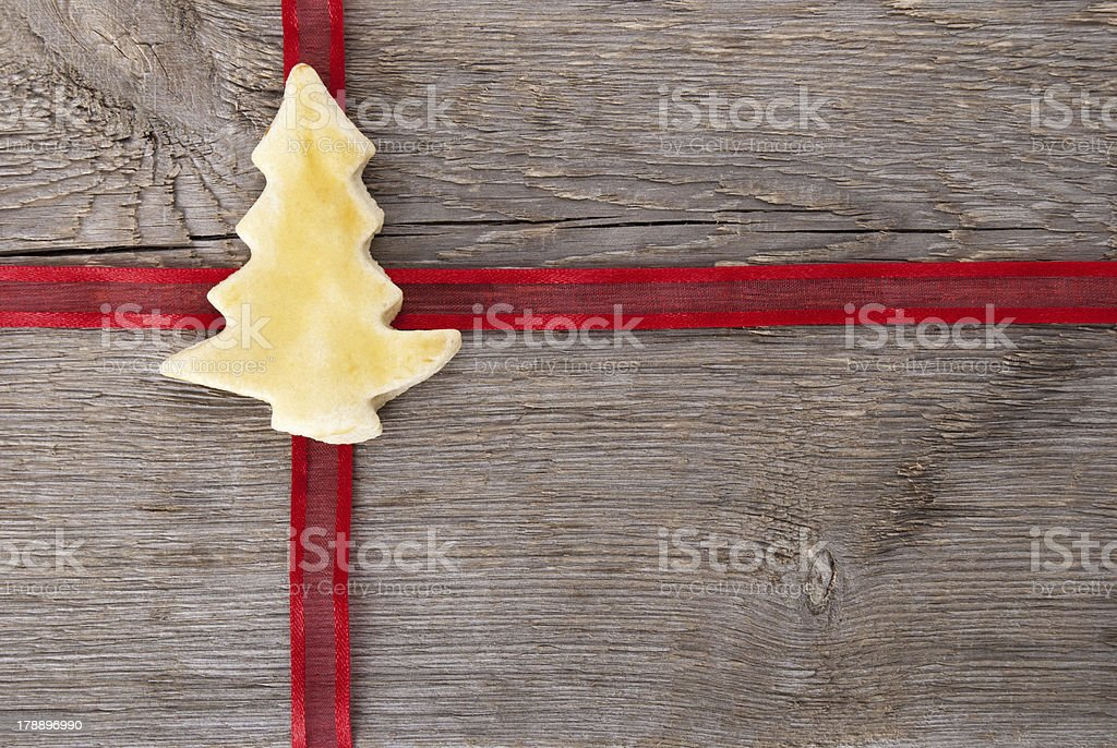 red ribbon with christmas tree cookie stock photo
