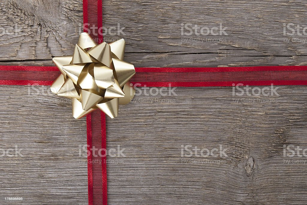 red ribbon with golden bow stock photo