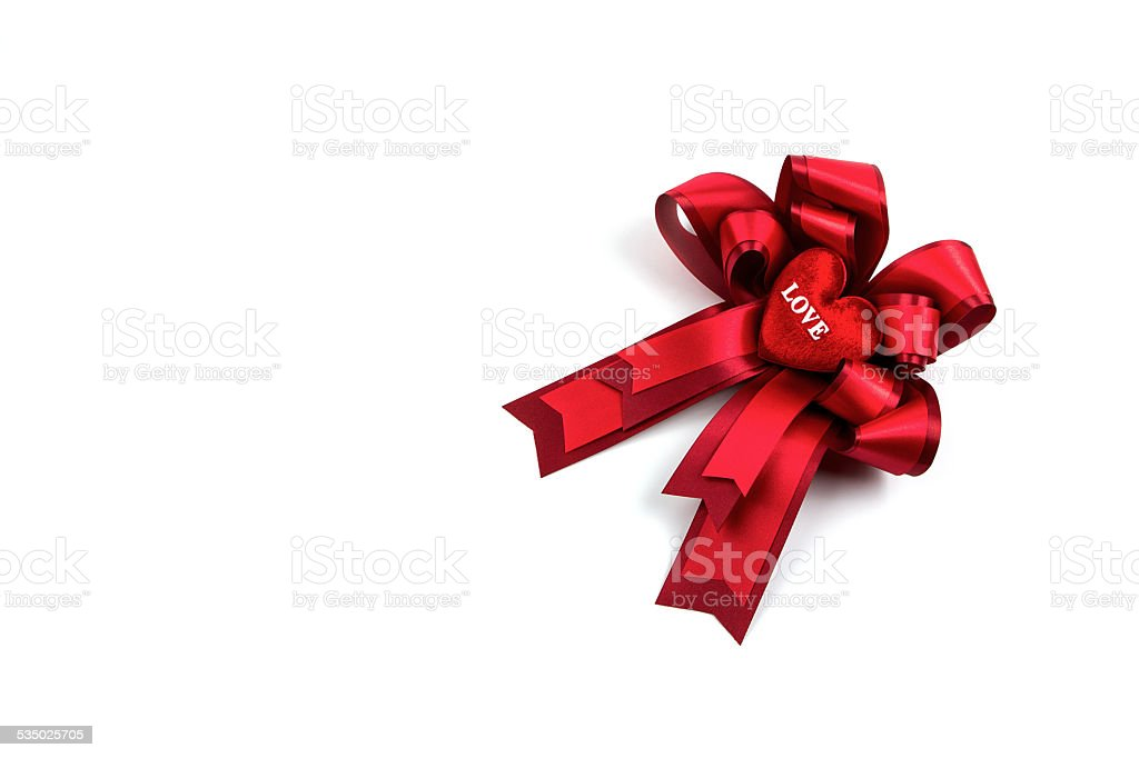 Red ribbon with love heart on white background stock photo