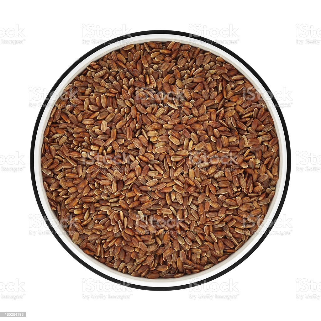 Red rice in a bowl from directly above stock photo