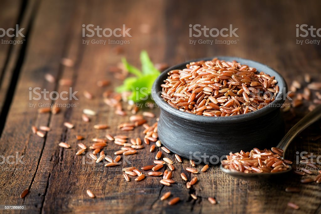 Red rice in a bowl stock photo